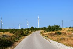 Wind turbines and power lines Royalty Free Stock Photo