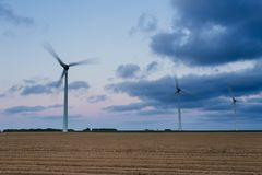 Wind turbines of a power plant for electricity generation in Normandy, France. Concept of renewable sources of energy Royalty Free Stock Photo
