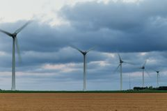 Wind turbines of a power plant for electricity generation in Normandy, France. Concept of renewable sources of energy Royalty Free Stock Images