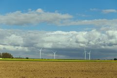 Wind turbines of a power plant for electricity generation in Normandy, France. Concept of renewable sources of energy Royalty Free Stock Image