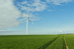 Wind turbines of a power plant for electricity generation in Normandy, France. Concept of renewable sources of energy Royalty Free Stock Photos
