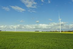 Wind turbines of a power plant for electricity generation in Normandy, France. Concept of renewable sources of energy Royalty Free Stock Photography