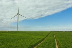 Wind turbines of a power plant for electricity generation in Normandy, France. Concept of renewable sources of energy Stock Photography