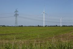 Wind turbines, power pole and power lines Royalty Free Stock Images