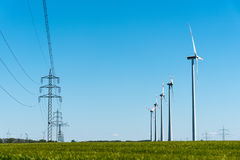 Wind turbines and power transmission lines in Germany Stock Photo