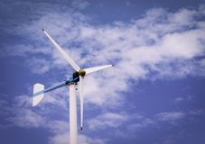 Wind turbines produce electricity or renewable energy. And blue sky Stock Photography