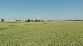 Wind turbines producing alternative energy. D-cinelike file for color grading stock video