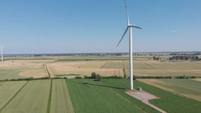 Wind turbines producing alternative energy. D-cinelike file for color grading stock video footage
