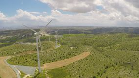 Wind turbines producing alternative green energy for modern plant or factory. Stock footage stock video footage