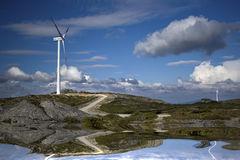 Wind turbines producing renewable electric energy stock photos