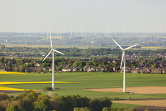 Wind Turbines And Rape Fields Royalty Free Stock Photography