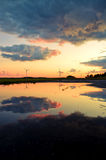 Wind turbines reflection in the water Stock Photo