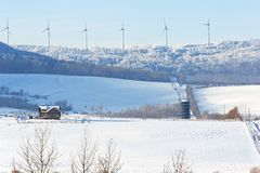 Wind turbines on a ridge in winter Royalty Free Stock Photography