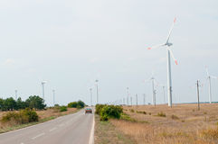 Wind turbines and a road Stock Photography