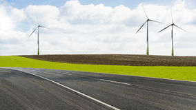 Wind turbines beside a road Stock Image