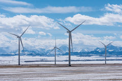 Wind Turbines with Rocky Mountains in the Winter Royalty Free Stock Photography