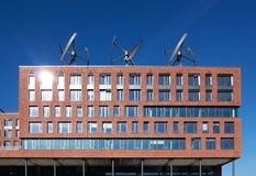 Wind turbines on roof of the building Stock Images
