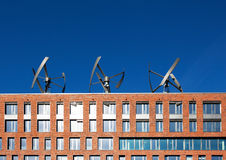 Wind turbines on the roof of a building Stock Photo