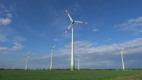 Wind turbines rotate and produce green electricity stock video