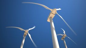 Wind turbines with rotating blades. Three white wind turbines with rotating blades on the blue sky background Stock Image