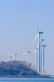 Wind turbines in Rotterdam harbor Stock Images