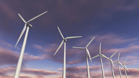Wind turbines in a row. A 3D rendered image of wind turbines in a row. A close up of electric mills with more green energy generators at the background stock illustration
