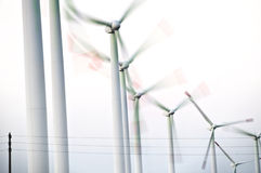 Wind turbines in a row stock photography