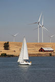Wind Turbines and Sailboat Royalty Free Stock Photos