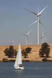 Wind Turbines and Sailboat Royalty Free Stock Images
