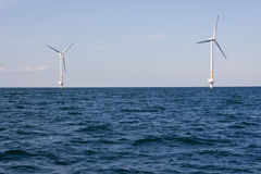 Wind turbines on a sea. Nearby Oland Island in Sweden Royalty Free Stock Photo