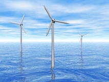 Wind turbines in the sea. 3D rendering of three wind turbines reflecting in the ocean Stock Photo