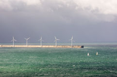 Wind turbines on sea Stock Image