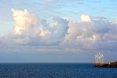 Wind turbines on sea with beautiful clouds Stock Photo