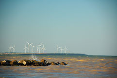 Wind turbines at the sea. Wind turbines, green energy and a sea Stock Images