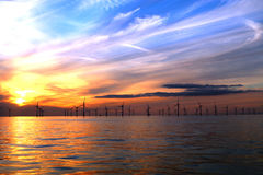 Wind turbines at sea. Wind turbines in the North Sea at night royalty free stock photo