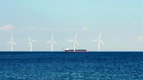 Wind turbines in the sea, on a sunny summer day. Blue sky. Ecological energy. Denmark. Baltic Sea stock image