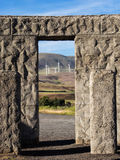 Wind turbines seen through stone door way Stock Images