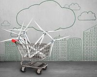 Wind turbines in shopping cart Royalty Free Stock Image