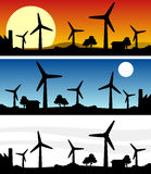 Wind Turbines Silhouette Banner. Three different wind turbines silhouette banners at dawn, at night and  on white background. Eps file available Royalty Free Stock Images