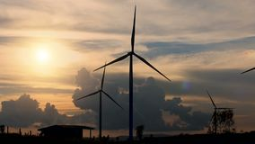 Wind turbines silhouette sunset landscape view produce clean energy. Electricity stock video