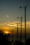 Wind turbines silhouette in the sunset sky Royalty Free Stock Image