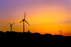 Wind turbines silhouettes Stock Photography