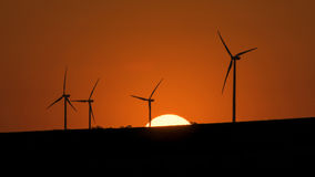 Wind turbines silhouettes. Windmill silhouette on sunset background.Landscape Royalty Free Stock Photography