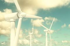 Wind turbines on the sky background Stock Photos