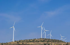 Wind Turbines , Blue Sky, Non Conventional Energy. Wind Turbines on the mountains to generate electricity from the Wind Energy Royalty Free Stock Photography