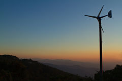 Wind turbines on sky at sunset. Royalty Free Stock Photography