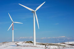 Wind turbines in snowy winter Royalty Free Stock Photo