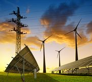 Wind turbines with solar energy panel and electricity transmission pylon. Wind turbines with solar energy panel and electricity transmission pylon on field royalty free stock image