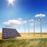 Wind turbines and solar panels royalty free stock photography