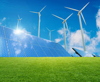 Wind turbines and solar panels stock photography